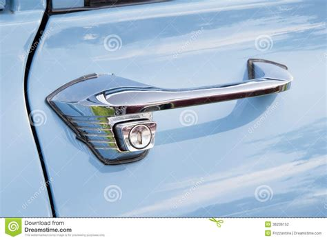 door handle of a blue vintage car stock photography image 36236152