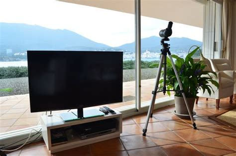 living room with big screen tv where to stay in cadaques sa costa luxury villa