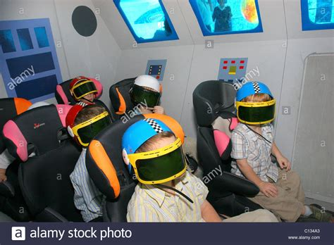 boat simulator vr children wearing vr helmets in a space shuttle simulator