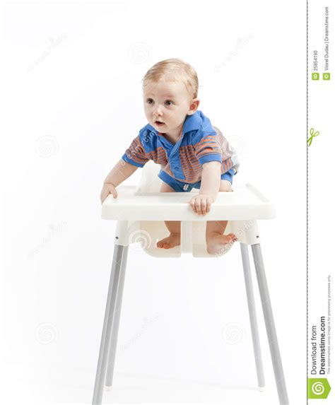 Baby In Chair by Baby Boy In High Chair Stock Photo Image Of Standing