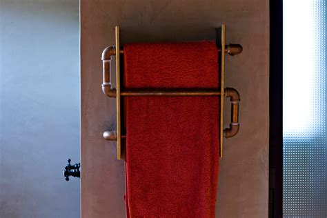 heated towel rack in spaces industrial with
