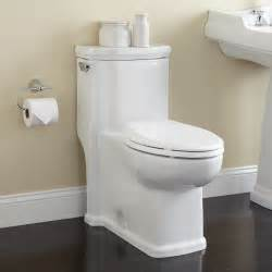bathroom with two toilets halcott one piece siphonic toilet elongated white