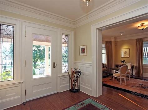 normal chair rail height traditional entryway with chair rail glass panel door in