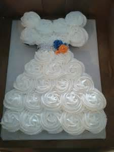 cupcake cake in the shape of a wedding dress for a bridal