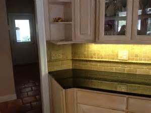 tumbled noce travertine backsplash custom home