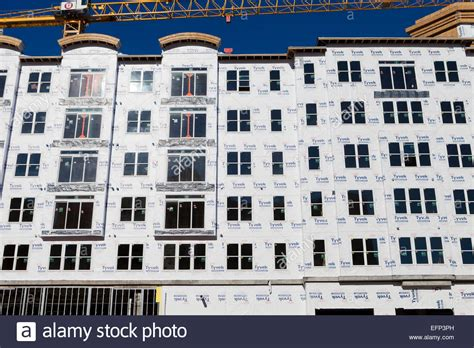 buy tyvek house wrap dupont tyvek house wrap applied on new condominium home construction stock photo