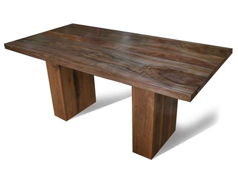 custom made walnut dining table with pedestal legs by fix