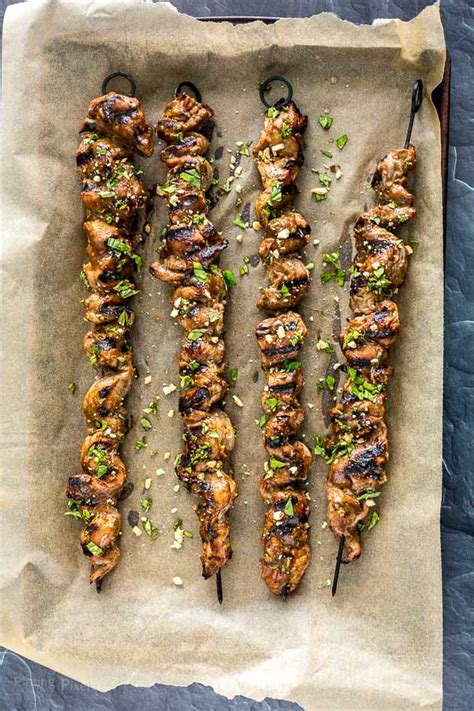 grilled pork satay skewers  homemade sauce plating