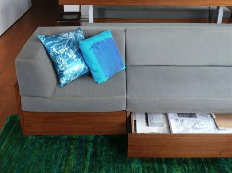 Sofa With Drawers Underneath by Tiny Studio Apartment With Ingenious Interior Design Solutions