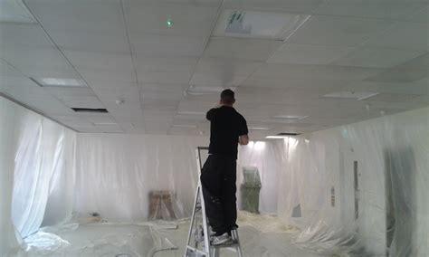 spray painter vs roller spray painting vs brush and roller painting
