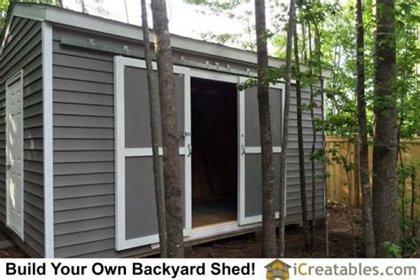 How To Hang A Shed Door by Sliding Barn Doors Installed On Shed By Hanging Them On