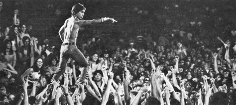 iggy pop stage dive iggy pop crowd surfing like a at a concert in