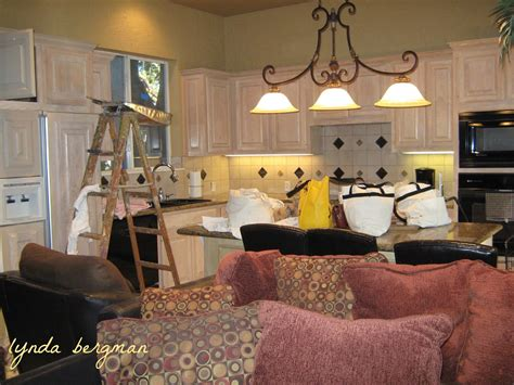 lynda bergman decorative artisan painting a special aging aged green kitchen cabinets refacing old cabinets ideas