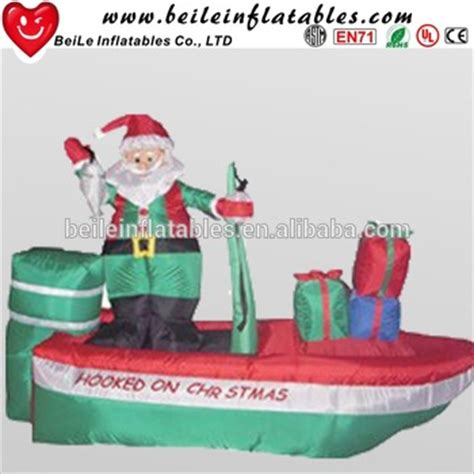santa in a boat inflatable inflatable santa claus on a fishing boat christmas yard