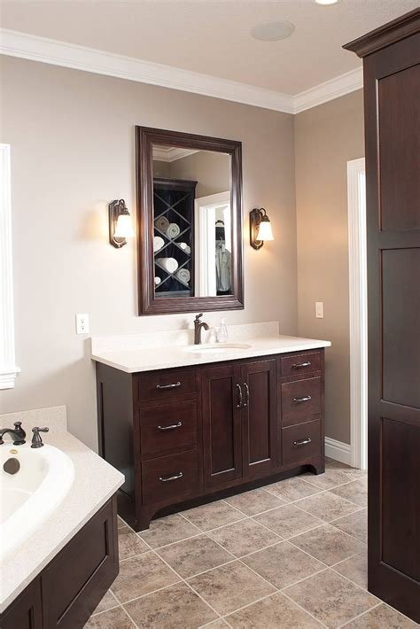 dark wood bathroom cabinets love the dark cabinets with the light marble and tile
