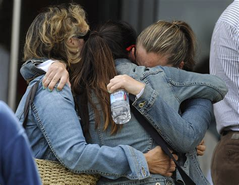 comfort each other relatives of one of the victims of a train crash comfort
