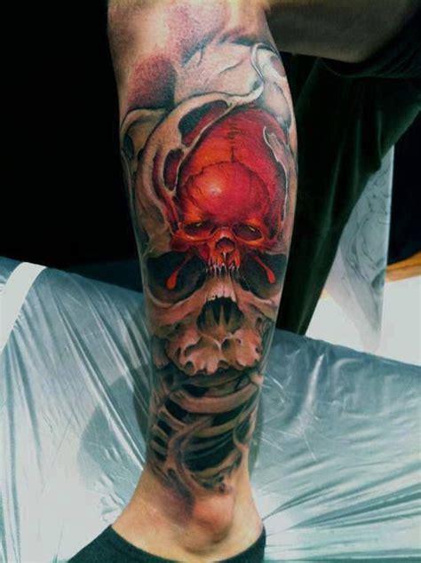 left leg 3d biomechanical skull tattoo ideas http