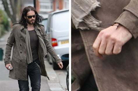 russell brand still isn t wearing his wedding ring oh and katy perry s still in hawaii