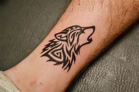 wolf wrist tattoo 60 tribal wolf tattoos designs and ideas
