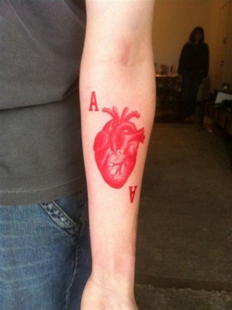 tattoo lettering in red ink red ink heart and letters forearm tattoo tattooimages biz