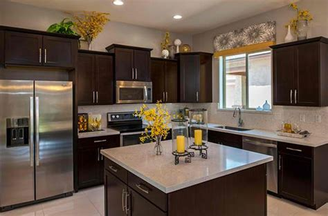 how to decorate the top of kitchen cabinets home design
