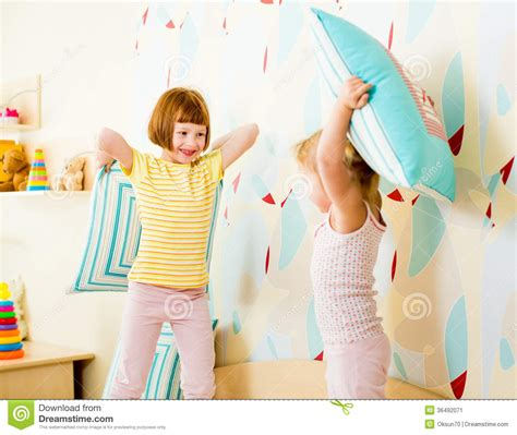 how to roleplay in the bedroom kids sisters play with pillows in the bedroom stock image