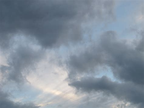 gray with blue grey clouds with blue notes on a valley