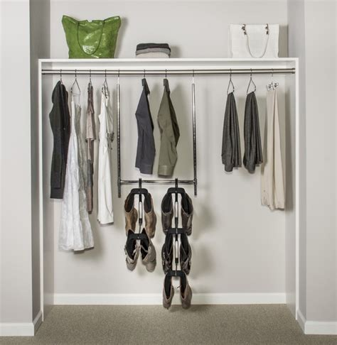 Boot Rack For Closet by Boot Butler Boot Rack Hanging From Lower Rod