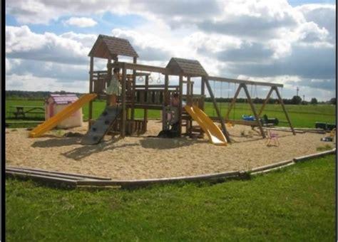 swing set ground cover ot ideas for ground cover under swingset babycenter