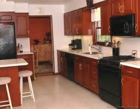 black appliances kitchen ideas cherry cabinets with black appliances