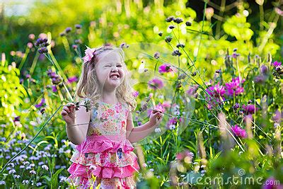 the flower childs play little in flower garden stock photo image 58581600