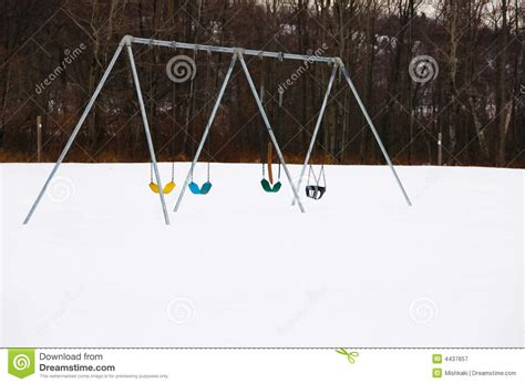 swing row row of swings on a winter day royalty free stock