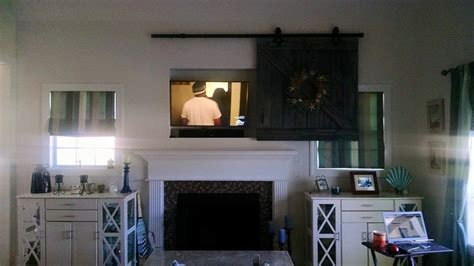 Barn Door Tv Cover Hometalk Barn Door Tv Cover