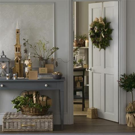 rustic grey christmas hallway with natural foliage