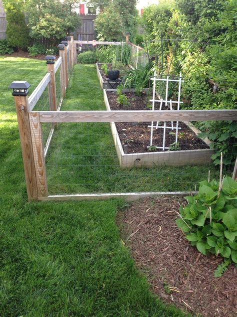 homemade garden fence  raised beds fenced vegetable