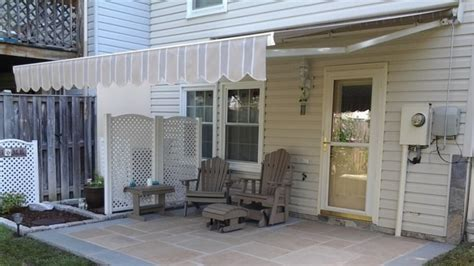 how to make a retractable awning the pros and cons of retractable deck awnings angie s list