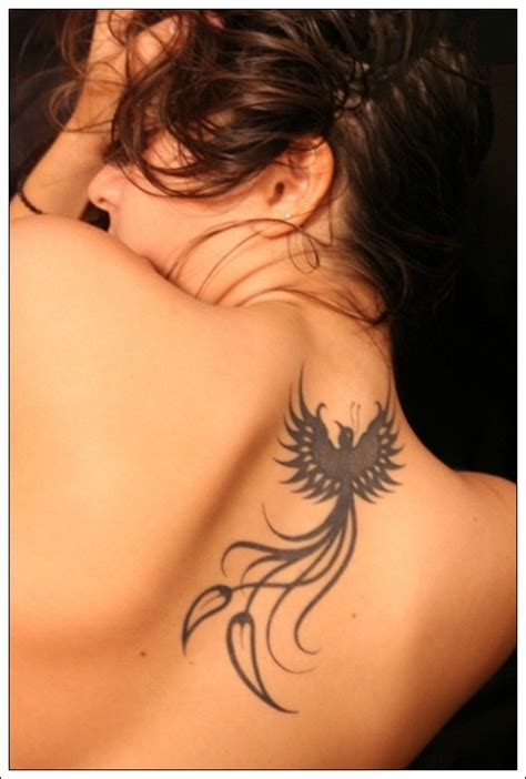 small bird tribal tattoos designs for girls on back
