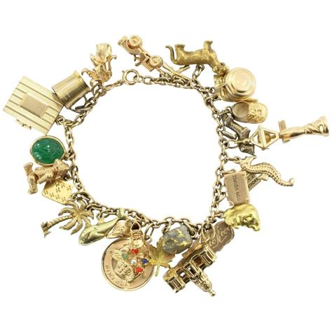1940s gold charm bracelet with cartier and and co