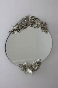 silver oval frameless venetian mirror with butterfly