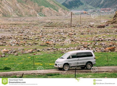 mitsubishi delica off road mitsubishi delica space gear on country road in spring