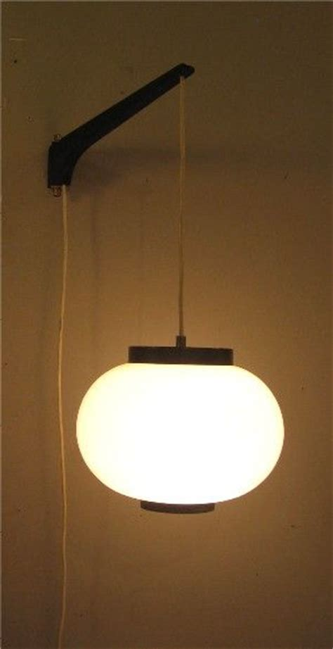 hanging pendant light based a wall bracket could work