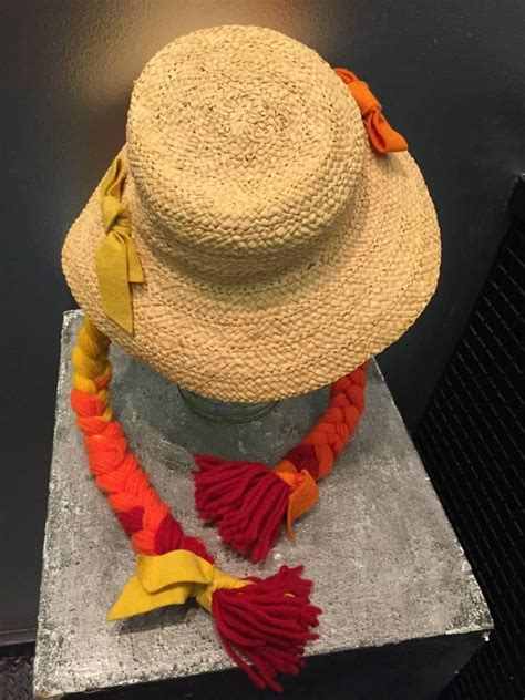box braids with a beach hat 1960s mr kenneth straw beach hat w red orange and yellow