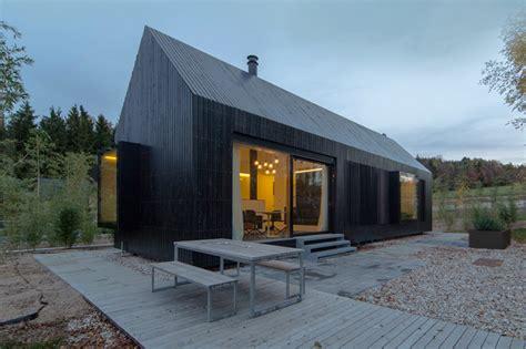 barn shaped houses format elf nestles dark barn shaped houses into bavarian