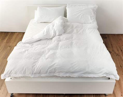 what happens if you wash a down comforter how to choose a down comforter you ll want to flaunt every day