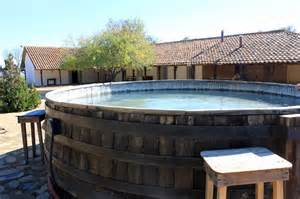 Airbnb Havana Cuba hot tubbing in a wine barrel at a winery in chile