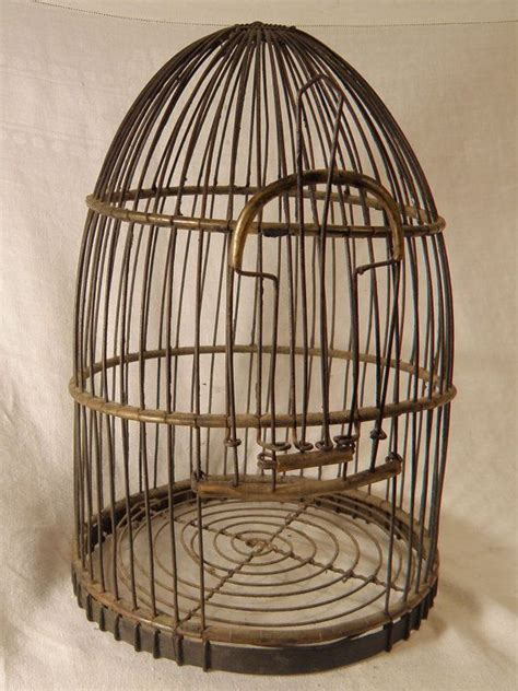 old wire bird cage with slide openings