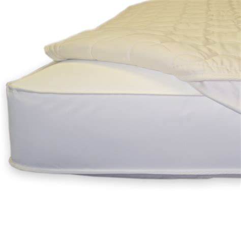 Mattress Pads For Cribs by Quilted Fitted Crib Mattress Topper By Naturepedic