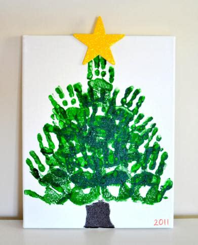 handprint christmas tree keepsake on canvas in lieu of