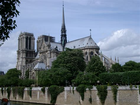 on the bank of the seine free stock photo of notre dame from the bank of the seine