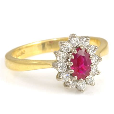 18ct yellow gold oval ruby and cluster ring from